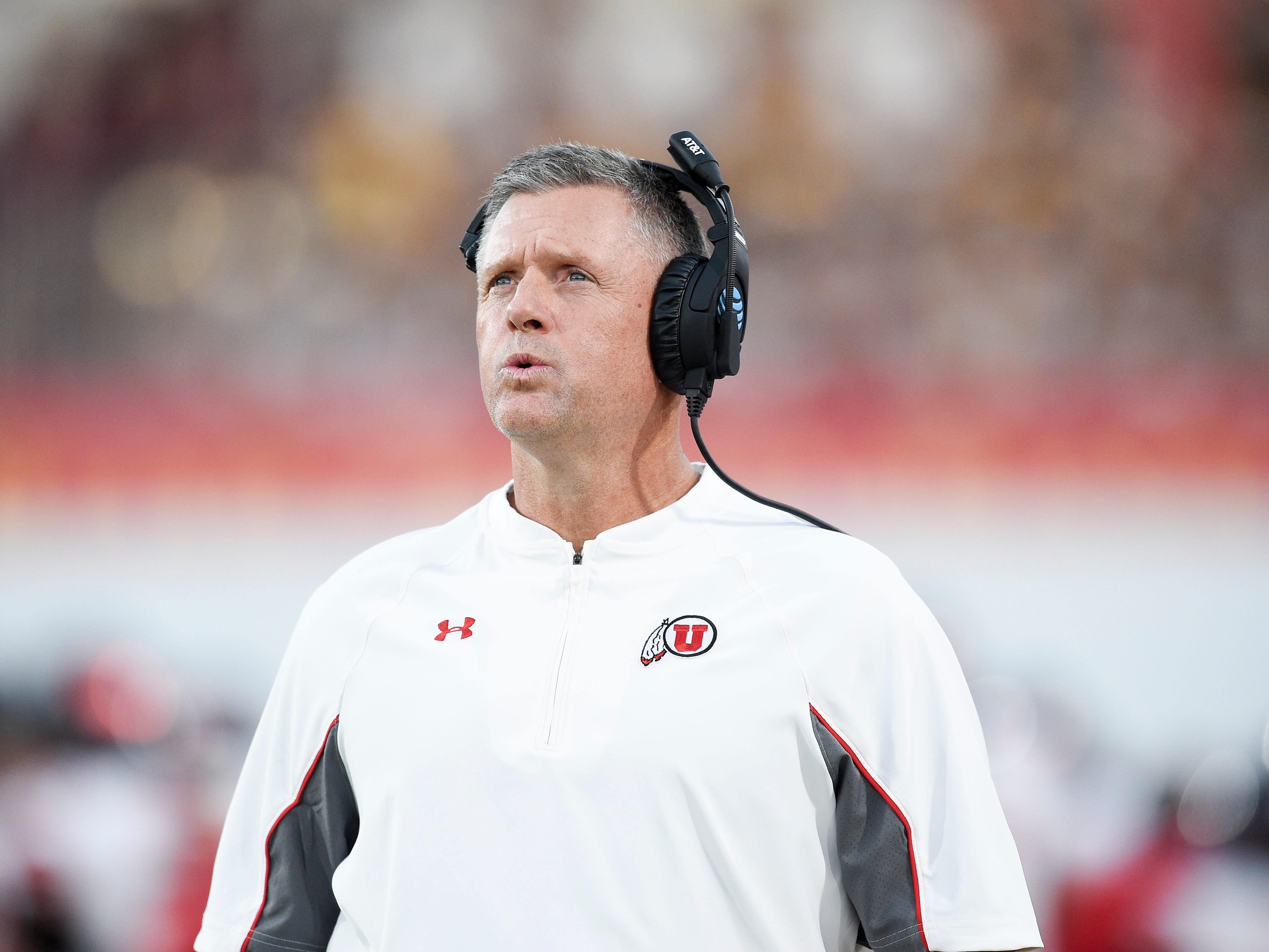 """This Oct. 14, 2017 photo shows Utah head coach Kyle Whittingham looking on from the sidelines during the first half of an NCAA college football game against the Southern California in Los Angeles. Whittingham joked with his sports information director near the end of his weekly news conference, Monday, Oct. 23, 2017 saying, """"Save me, Liz. Save me."""" Things have fallen apart for Utah and there's no clear explanation why. Whittingham has taken responsibility and said the coaches need to be better, but production has fallen off across the board. (AP Photo/Kelvin Kuo)"""