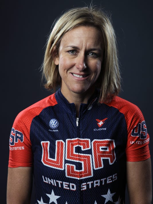 FILE - In this March 8, 2016, file photo, cyclist Kristin Armstrong poses for photos at the Team USA Media Summit in Beverly Hills, Calif. As the U.S. team heads for the Rio Olympics, the women wearing the stars-and-stripes are among the heavy favorites in several disciplines. (AP Photo/Jae C. Hong, File)