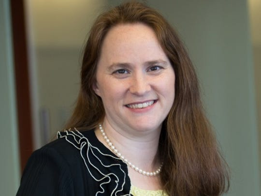 Valerie Brader, pictured, deputy legal counsel and senior policy adviser to the governor, wrote in an October 2014 email to chief of staff Dennis Muchmore and other top aides to Gov. Rick Snyder, saying the return to Detroit's water system for the city of Flint made economic and environmental sense, calling it an urgent matter to fix.