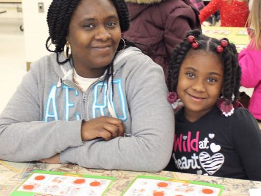 636263115564407224-QML---Ameenah-Rhoades-and-her-mother-Taira-Williams-playing-math-bingo..JPG