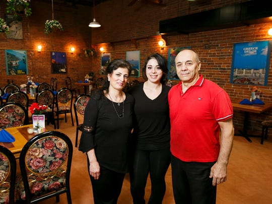 George Doughly and his wife Nahla Armouch, with daughter Mariana Armouch, will be closing Macedonia Greek Cuisine in the Reed Opera House on February 28.