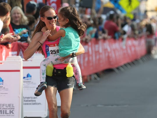 Becky Frazier, Newmarket, NH, runs to the finish line