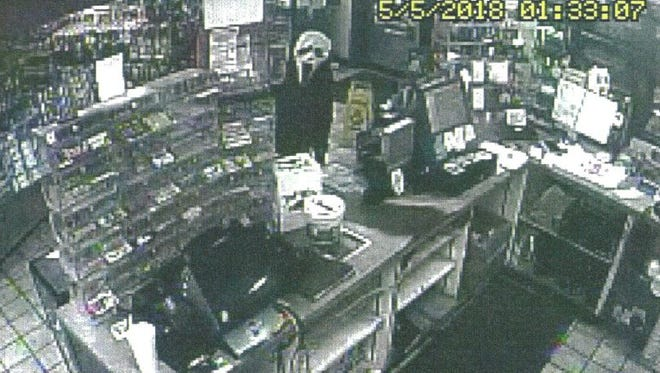 """The man wearing this """"Scream"""" mask robbed the Williamsport BP on Indiana 28 on the north end of town about 1:40 a.m. Saturday. If anyone knows anything about this crime, please call the sheriff's office at 765-762-7234."""
