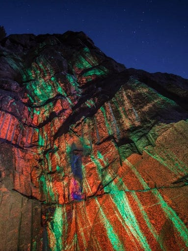 A 19-by-9 foot slab of fluorescent rock was cut from
