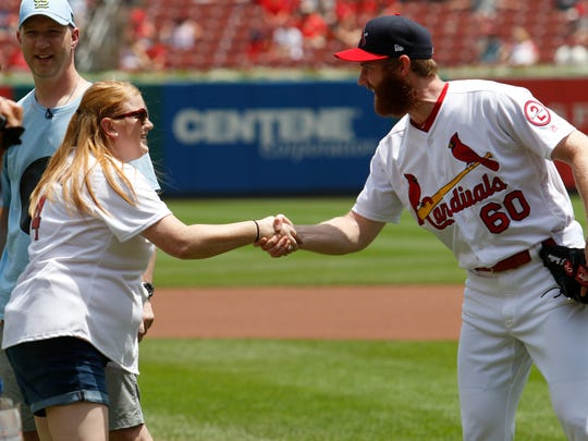 Former Springfield Cardinals pitcher John Brebbia shakes hands with Beth Larsen after the first pitch ceremony at Busch Stadium in St. Louis on July 1, 2018.