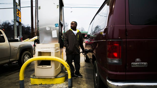 "January 3, 2017 - Carl Hill, owner of Deez Transport, a personal chauffeur service, fills his van with gasoline at Q Mart at 2133 Lamar Ave., where fuel was priced at $2.13 per gallon on Tuesday. The cost is the highest new year price in two years, and up 14 cents in a month. ""The gas prices are high, no joke. There's really nothing we can do about it - just try to still live and make means,"" Hill said, who expected to spend between $64-$65 to fill up his 15 passenger vehicle. ""Normally it costs me about $45,$50. We gotta have gas. We gotta use it and I need it due to the business that I do."""