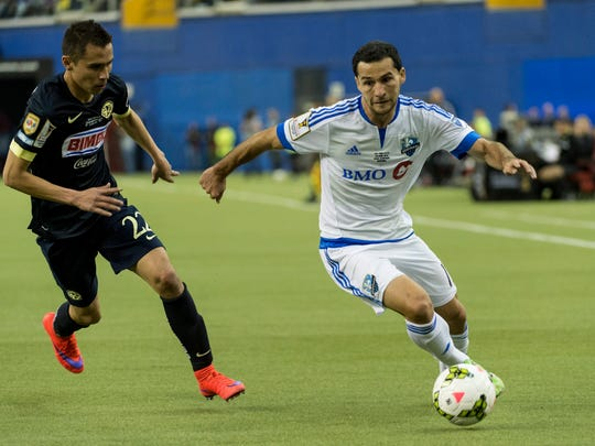 Montreal Impact midfielder Dilly Duka controls the ball away from Club America defender Paul Aguilar during first half of the CONCACAF Champions League soccer final match in Montreal, Wednesday, April 29, 2015. (Paul Chiasson/The Canadian Press via AP) MANDATORY CREDIT