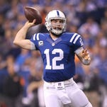 Indianapolis Colts quarterback Andrew Luck (12) drops back to pass in the second half of their game. The Indianapolis Colts host the Cincinnati Bengals in the AFC Wild Card game Sunday, January 4, 2015, afternoon at Lucas Oil Stadium.