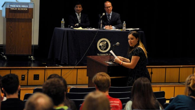 Pascack Hills High School graduate Hannah Elyse Simpson, class of 2003, offers herself as source of information for students and parents who might have any questions regarding transgender issues. After college Simpson transitioned from her assigned male gender to her gender identity as a female. Simpson spoke during the question and answer portion of an information session on the proposed transgender student policy held at Pascack Hills High School in April 2016.
