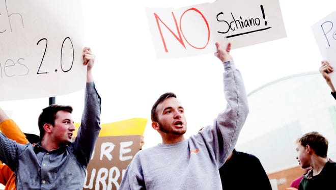 UT sophomore Jake Tidwell chants outside of the UT Athletics offices during a gathering of Vol fans reacting to the possible hiring of Ohio State Buckeyes defensive coordinator Greg Schiano for UT head coach outside of Neyland Stadium in Knoxville, Tennessee on Sunday, November 26, 2017.