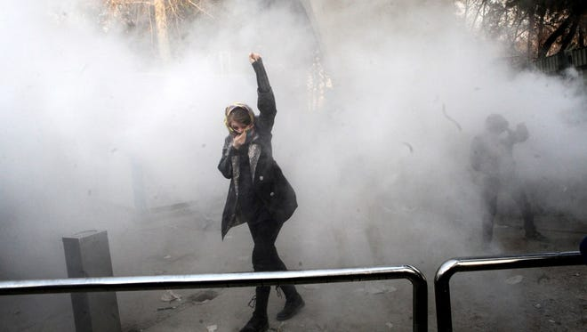 Iranian students clash with riot police during an anti-government protest around the University of Tehran, Iran, on Dec. 30, 2017.