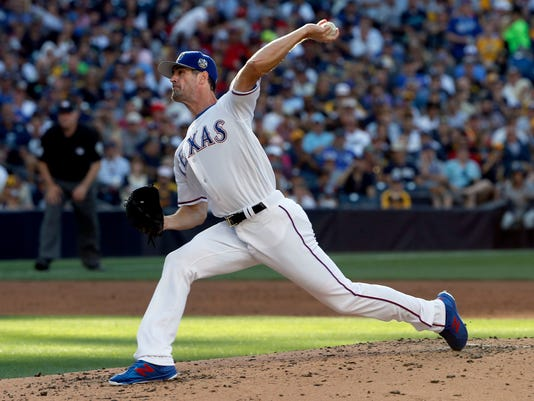 American League's Cole Hamels, of the Texas Rangers, pitches against the National League during the third inning of the MLB baseball All-Star Game, Tuesday, July 12, 2016, in San Diego. (AP Photo/Lenny Ignelzi)