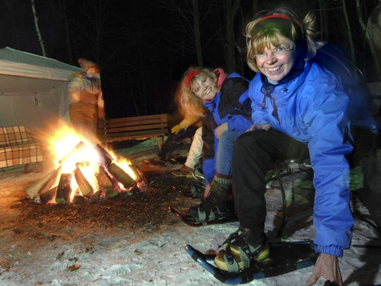 Linda Moscherosch, right, and Kathy Baumann of Wausau get ready to take a candlelight snowshoe hike through the trails on Rib Mountain.