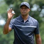 Aug 21, 2015; Greensboro, NC, USA; Tiger Woods waves to the crowd after a birdie on the 3rd hole during the second round of the Wyndham Championship golf tournament at Sedgefield Country Club. Mandatory Credit: Rob Kinnan-USA TODAY Sports