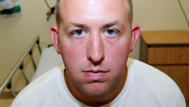 A photo provided by the St. Louis County Prosecuting Attorney's office shows Ferguson police officer Darren Wilson in 2014.