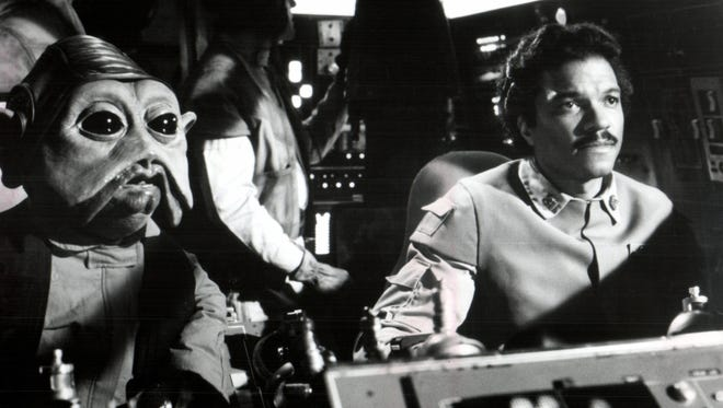 "Billy Dee Williams as Lando Calrissian, right, and Nien Nunb, his Rebel co-pilot, at the controls of the Millennium Falcon in ""Return of the Jedi."""