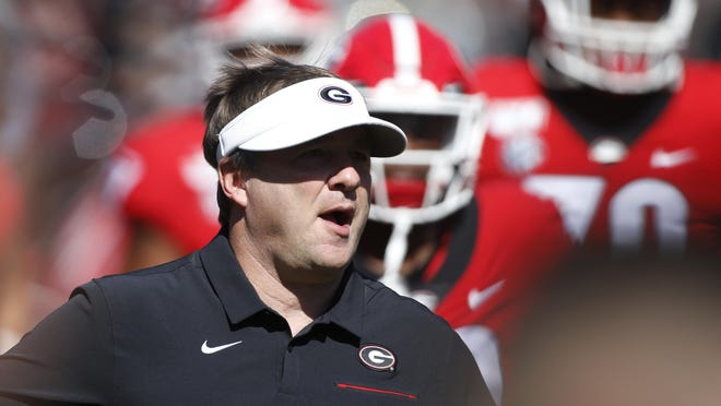 Georgia coach Kirby Smart and his team take the field before kickoff of a game against South Carolina in Athens on Oct. 12, 2019.