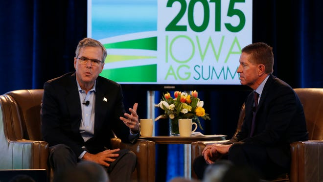 Former Florida Gov. Jeb Bush answers question from Bruce Rastetter Saturday, March 7, 2015 during the Iowa Ag Summit in Des Moines.