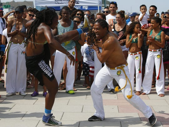 Members of Capoeira Sol Nascente of Long Branch,NJ , perform Capoeira on the boardwalk during Oceanfest in Long Branch,NJ. Monday, July 4, 2016. Noah K. Murray-Correspondent/Asbury Park Press ASB 0705 Oceanfest