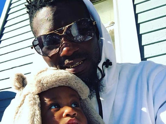Dymere Graham with his son.