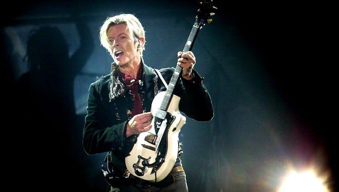 Rock legend David Bowie performs in 2003 at Forum, in Copenhagen, Denmark.