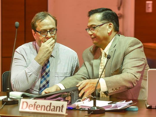"""Attorney Joaquin """"Jay"""" Arriola Jr., right, speaks to his client, Michael Ehlert, during a break in trial proceedings at the Superior Court of Guam in Hagåtña on in this July 27, 2017, file photo. Ehlert was found guilty of one count of third-degree criminal sexual conduct and one count of attempted third-degree criminal sexual conduct."""