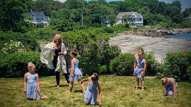 Dance instructor Sharon Lux and a few of her students are seen here during a special recording of their performance at a local beach house on June 20. Dancers and their families will watch a film of their performance at the Saco Drive-in on July 13.