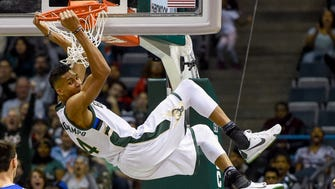 Giannis Antetokounmpo dunks against the 76ers during a game earlier this season.