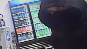 Footage of a man Buncombe County sheriff's deputies say robbed an Emma Road convenience store with a shotgun Saturday night.