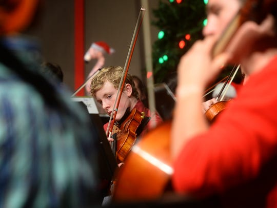 The Steve Olson Orchestra rehearses for a Christmas concert at CMR.