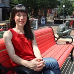 Rachel LeBeau poses for a photo on the pedestrian mall on Friday, July 10, 2015. David Scrivner / Iowa City Press-Citizen