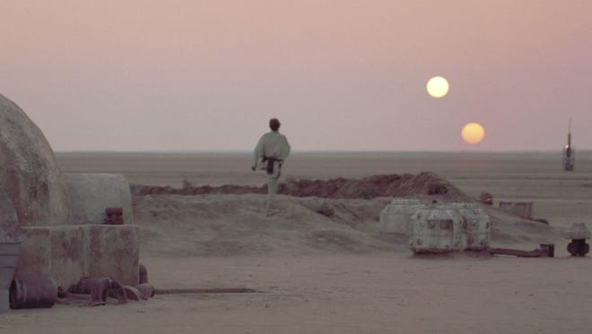 Scientists say a fast-moving sand dune could overrun the movie set used to portray the planet Tatooine in 'Star Wars.' Other filming locations in Tunisia have already vanished under sand.
