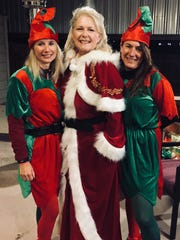 Abilene Wednesday Rotarians Jana Herndon, Celia Gesting and Valarie Kennedy attend the Texas Media co-sponsored Christmas gift giving for children at New Horizons.