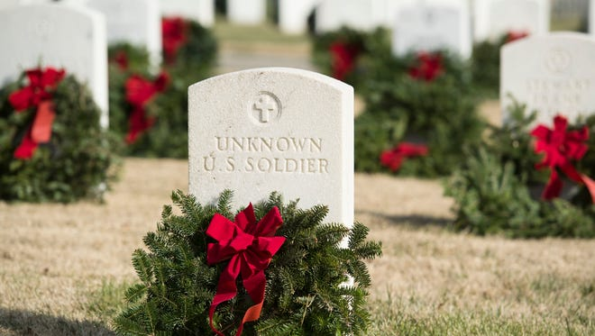A wreath from Wreaths Across America on the grave of an unknown soldier at Knoxville National Cemetery on Saturday, December 16, 2017.