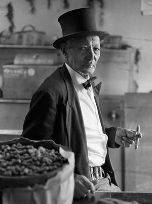 """""""Peanut Jim"""" Shelton, seen in 1973 in his trademark formal attire, sold roasted peanuts around Cincinnati for 50 years, most famously at Reds games."""