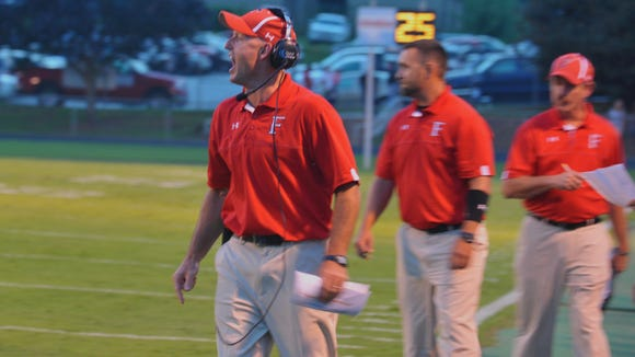 Franklin head coach Josh Brooks had some harsh words after a call during the football game against TC Roberson on Sept. 5, 2014.