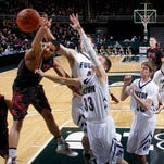 Fulton's Kaleb Brunner (33) and Brendan Hulbert, rear, and Powers North Central's Morgan Cox, top left, battle for a rebound during their MHSAA Class D semifinal game Thursday, March 26, 2015, at the Breslin Center in East Lansing, Mich. Watching are North Central's Marcus Krachinski (3) and Fulton's  Kyle Thomas (30) and Evan Schneider (14). Fulton fell 71-46.