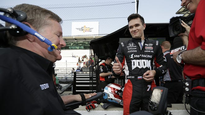 IndyCar driver Mikhail Aleshin (7) celebrates with team owner Sam Schmidt,left, following his qualifying run for the 100th running of the Indianapolis 500 Saturday, May 21, 2016, morning at the Indianapolis Motor Speedway.