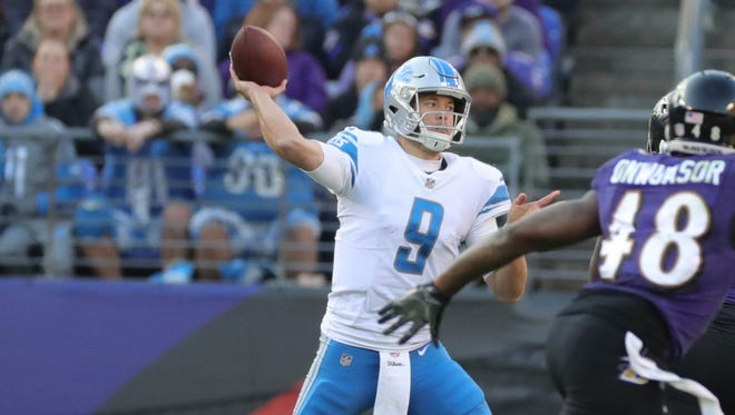 Lions quarterback Matthew Stafford passes during the third quarter against the Ravens on Sunday.