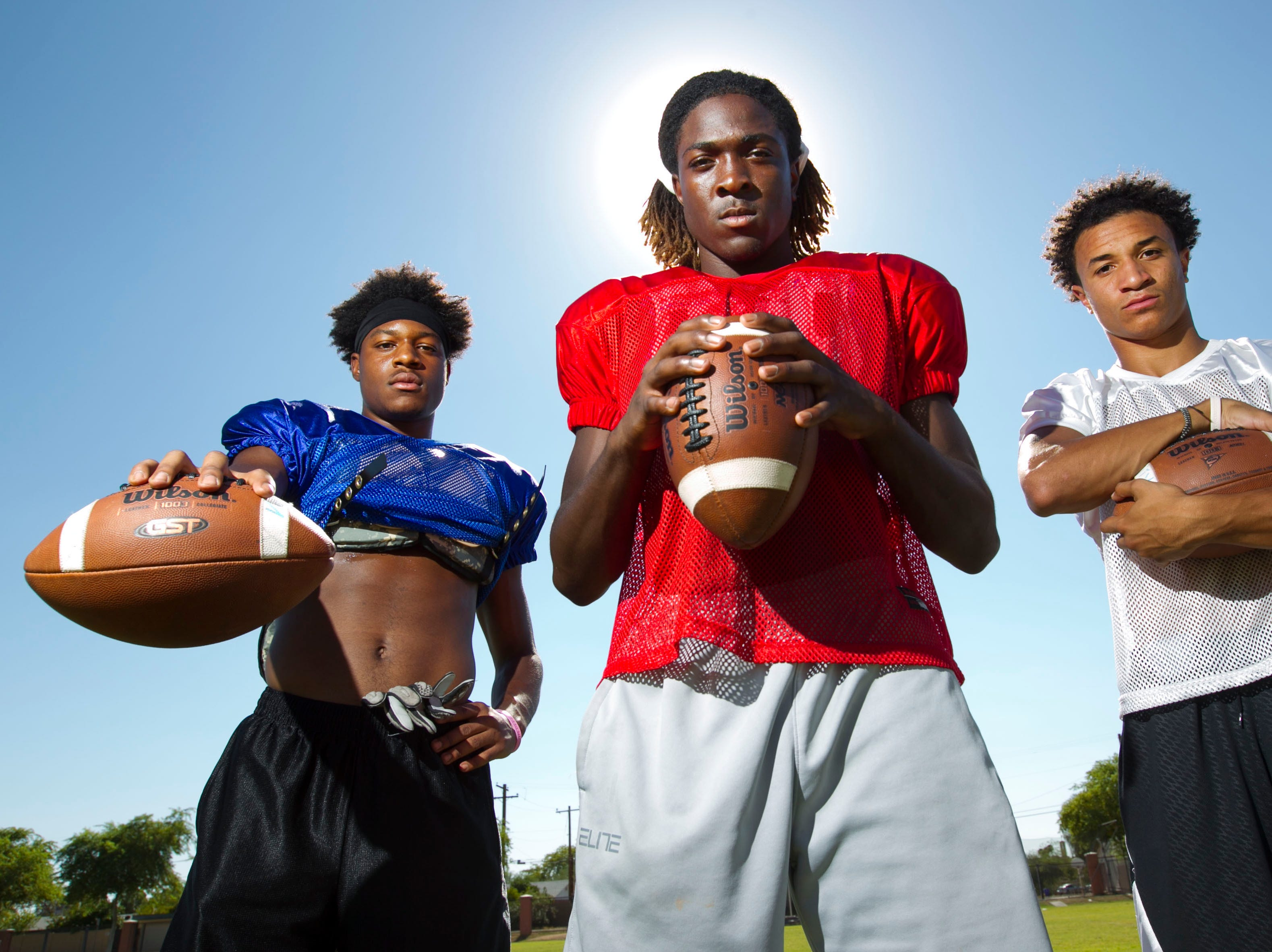 Chandler High football players (from left) N'Keal Harry, Bryce Perkins and Chase Lucas will lead the Wolves this season.