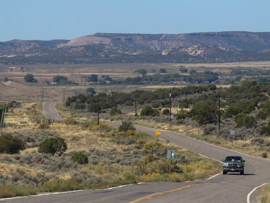 A vehicle heads east on N.M.Highway 574 Tuesday near