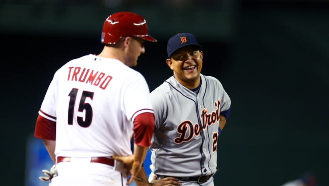Detroit Tigers third baseman Miguel Cabrera (right) laughs with Arizona Diamondbacks outfielder Mark Trumbo at Chase Field on July 21, 2014.