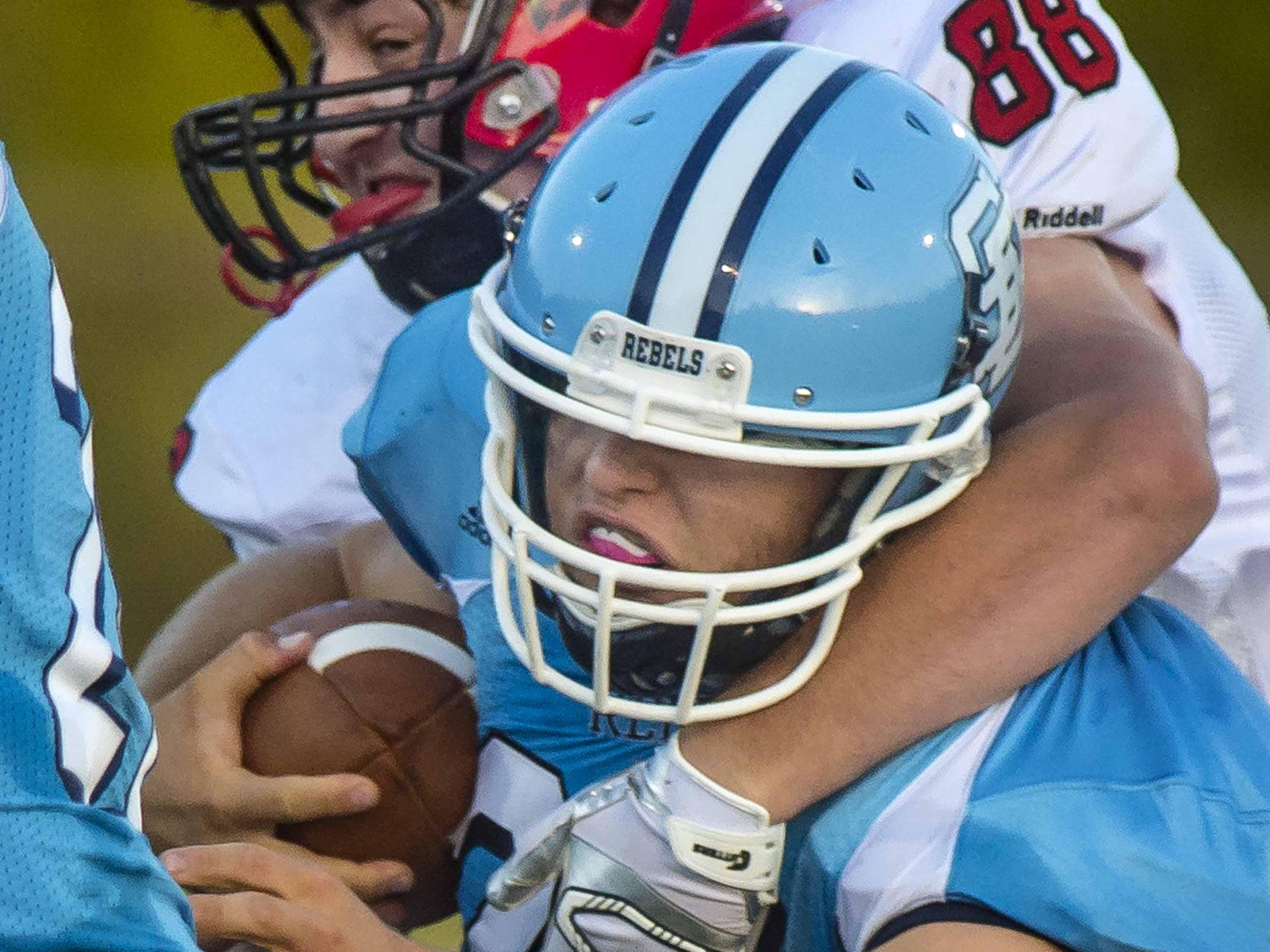 South Burlington's Henry Cunningham, front, is wrapped up by CVU's Zach Toensing in South Burlington on Friday, September 4, 2015.