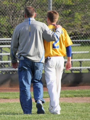 Pat Keehan, left, and son Kyle walk off the field together Wednesday after Gibraltar's 10-0 win over Mishicot.