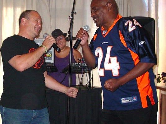 Hal Jensen, left, and business partner Steve Starr sing a karaoke duet on Ra.JPG