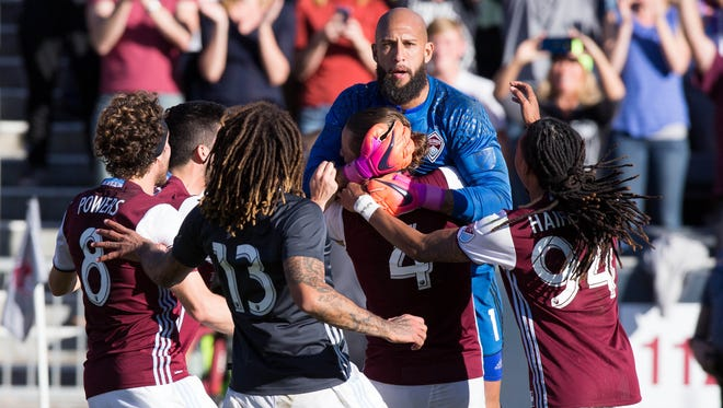 Nov 6, 2016; Commerce City, CO, USA; Colorado Rapids midfielder Dillon Powers (8) and midfielder Jermaine Jones (13) and defender Marc Burch (4) and midfielder Marlon Hairston (94) congratulate goalkeeper Tim Howard (1) after the match against the Los Angeles Galaxy at Dick's Sporting Goods Park. Rapids win 1-0 in a shootout (3-1).