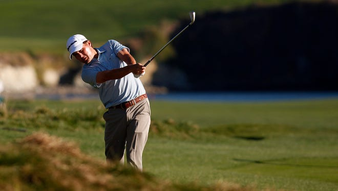 Kevin Kisner hits his ball from the rough on the 18th fairway at Pebble Beach Golf Links on his way to winning the Callaway Pebble Beach Invitational.