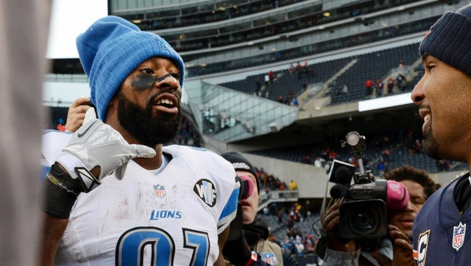 Chicago Bears running back Matt Forte and Detroit Lions wide receiver Calvin Johnson, left, talk about getting together during the off-season after a game Sunday, Jan. 3, 2016, at Soldier Field in Chicago.