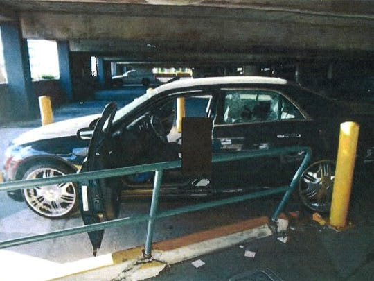 Cpl. Allan DeVillena II was driving this black Chrysler 300 when he was fatally shot by Palm Springs police on Nov. 10, 2012. After the shots were fired, the car crashed a column near the east exit of the public parking garage downtown.
