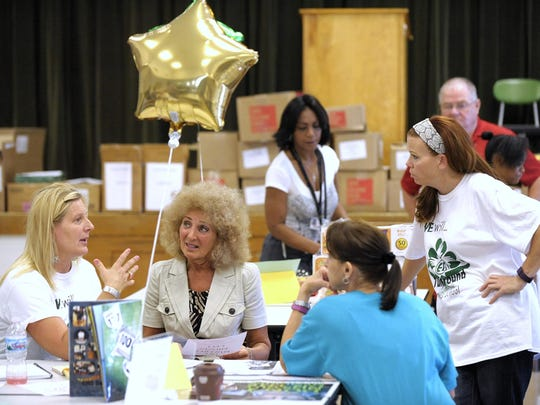 (L-R): Eighth grade math teacher / yearbook coordinator Kim Zatelli, 46, of Clinton Twp., principal Fran Hobbs, of Northville Twp., advanced learning program teacher Cel Sweeney, 54, of Clinton Twp, and science teacher Susan Jowsey, 44, of Grosse Pointe Farms, talk during the program.